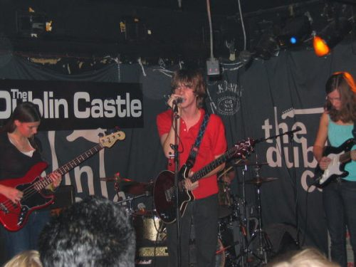 Image of a guitarist and band on stage